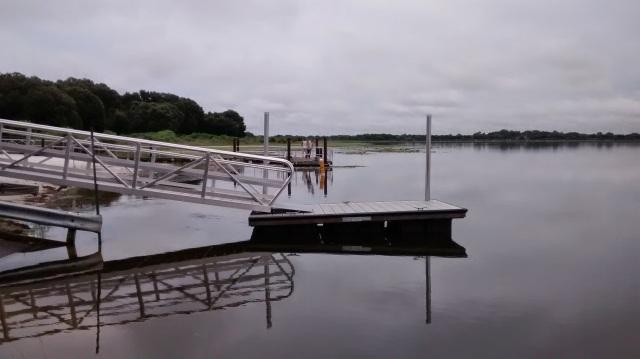 Little boat dock is floating-not on bottom