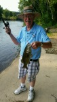 """Jim Barksdale of the """"Infamous Barksdale Clan"""" holds a smallmouth."""