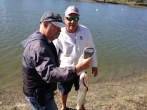 John Krainert weighing Bob Knorr's catch